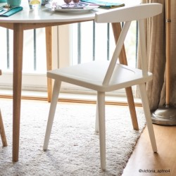 minimalist wooden dining chair in white mood shot