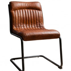 Real leather cantilever frame vintage dining chair in brown.